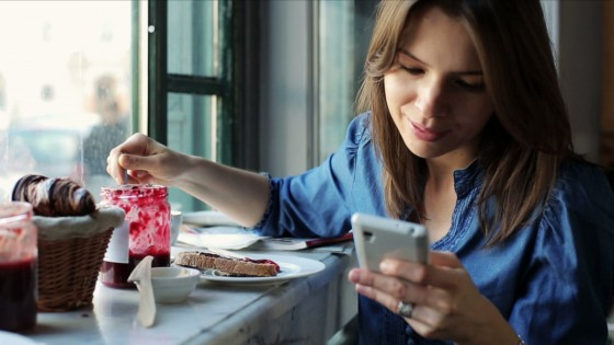 stock-footage-woman-texting-sending-sms-on-smartphone-in-bar